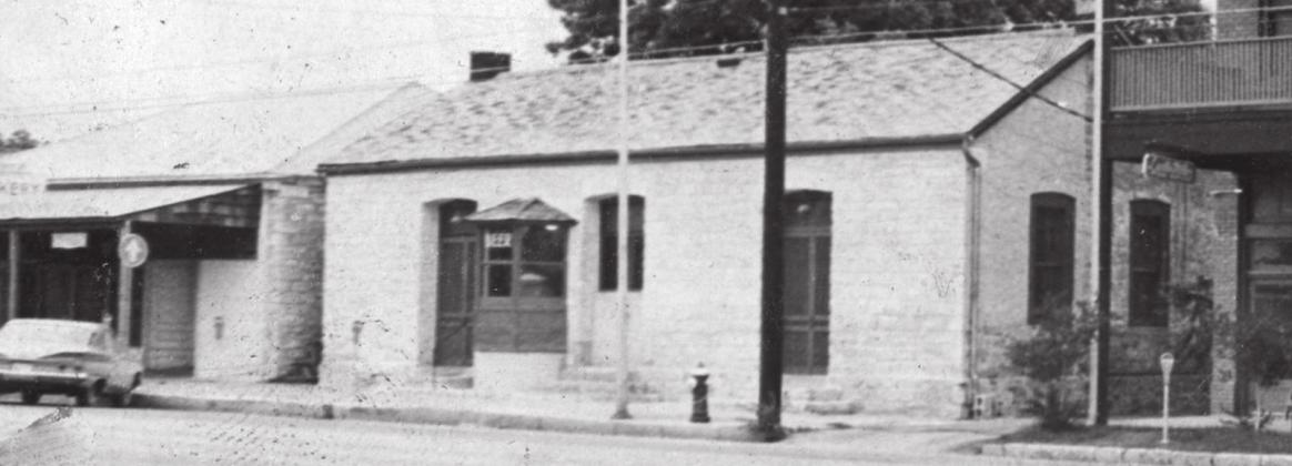 The old Domino Parlor building, circa 1974, located at 222 East Main Street. — Image courtesy of the Gillespie County Historical Society
