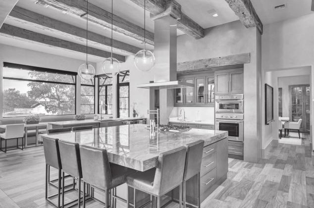 Chateau Serendipity, built by Laughlin Homes and Restoration, was recently recognized with multiple 2020 Best in American Living Awards. The home features exposed wood beams, a custom banquet table and a breakfast nook. — Submitted photo