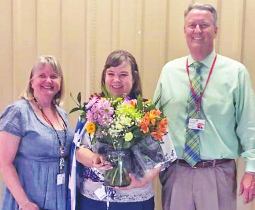Fredericksburg Independent School District recently honored Jamie Page, center, a fourth and fifth grade math teacher at Stonewall Elementary School, with Elementary Teacher of the Year. Presenting her the award was SES Principal Amie Chalberg, left, and Supt. Dr. Jeffrey Brasher. — Submitted photo