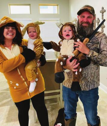 The Burkett family, dressed as deer and a hunter, received second place. Pictured from left is Brianne Burkett, Daxton Burkett, Denver Burkett and Colt Burkett.