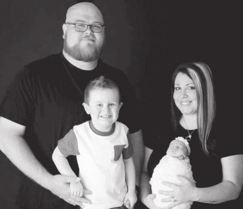 The Tims family from left, Justin Tims, Brady, Leanne and baby Heidi, who is 15 months old. — Submitted photo