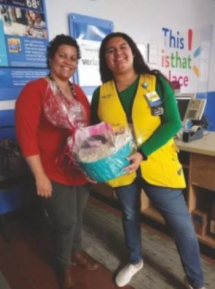 "Zytka Victorica, right, was ""adopted"" by one of her Walmart coworkers, Liz Vanessa Miranda, who bought her a watch and some journaling supplies."
