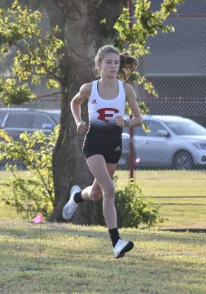 Fredericksburg High School freshman Taylor Grona sets her pace on Saturday during a dual cross-country meet. Grona completed the course more than two minutes ahead of her competitors.
