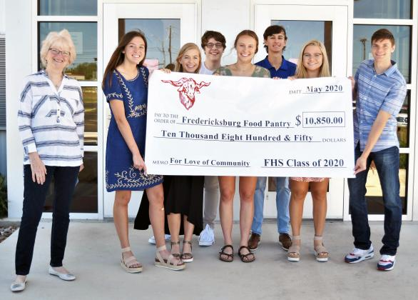 Merrilyn Hartmann, secretary of the Fredericksburg Food Pantry Board, accepts a donation of $10,850 from the Fredericksburg High School Class of 2020 representatives, including, front, from left, Amy Dittmar, Allison James, Caitie Huff, Emilia Smajstrla and Ryan Davis; back, Noah Downey and Chad Braden. Engravers donated the big check to FHS. — FHS Comet Staff photo