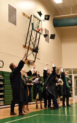 The 2020 graduates toss their hats as a last act of togetherness at the end of the graduation ceremony.