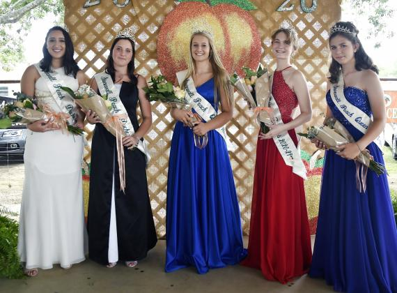 A new Stonewall Peach Queen and Duchesses were crowned Saturday at the Stonewall Chamber of Com-merce. Receiving crowns were, from left, Second Duch-ess Viviana Carreno, Third Duchess Jolie Penry, Peach Queen Abigail Schladoer, First Duchess Sophia Mills and Fourth Duchess Rachel King. — Standard-Radio Post/Joshua McKinney