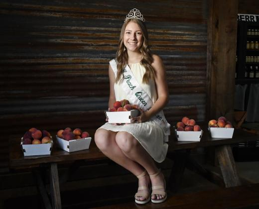 While the Stonewall Peach JAMboree was canceled in late May due to the coronavirus pandemic, the queen's contest will still proceed. Reigning Stonewall Peach Queen Autumn Kirchner, pictured at Jenschke Orchards, will pass her crown off to a new queen during the contest set for Saturday, June 27. The contest is set for 3 p.m. at the Stonewall Chamber of Commerce. See page C/D10 for contestants vying for the crown. — Standard-Radio Post/McKenzie Moellering