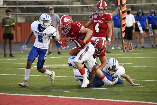 Running back Gavin French drags in defenders on the first of his four first-half touchdowns. The senior standout had 11 carries for 115 yards. – Standard-Radio Post/Ken Esten Cooke