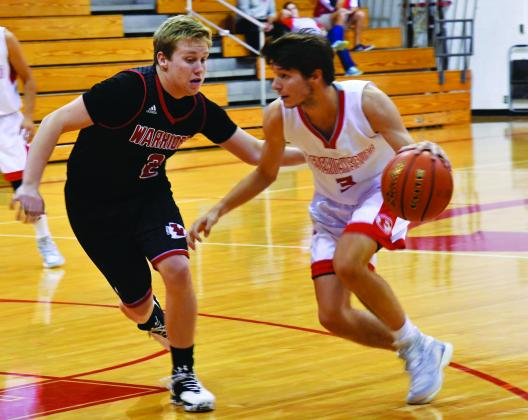 FHS senior Levi Esensee moves past an Ingram player on Friday night. Esensee was the leading scorer for the Billies with 21. – Standard-Radio Post/McKenzie Wedel