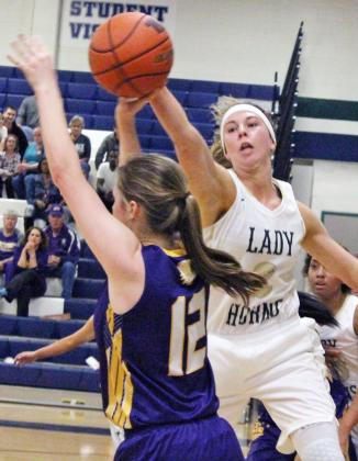 Harper High School basketball player Logan Menzies (3) swats a shot by Shiner's Abby Thomas in the Ladyhorns' 36-34 Class 2A bi-district loss Tuesday, Feb. 14, in Round Rock. — Standard-Radio Post/Danny Hirt