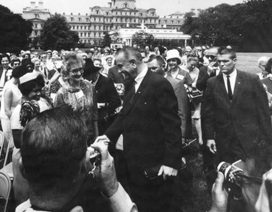 Secret Service Agent Jim Hardin, right, shown on protective detail with President Lyndon Baines Johnson. – Photo courtesy of Hardin family