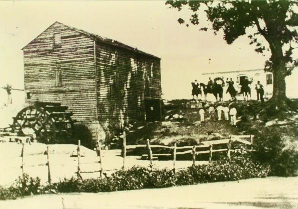 This photo, circa 1851 shows the original Pioneer Mill along the banks of Live Oak Creek. — Standard-Radio Post file photo