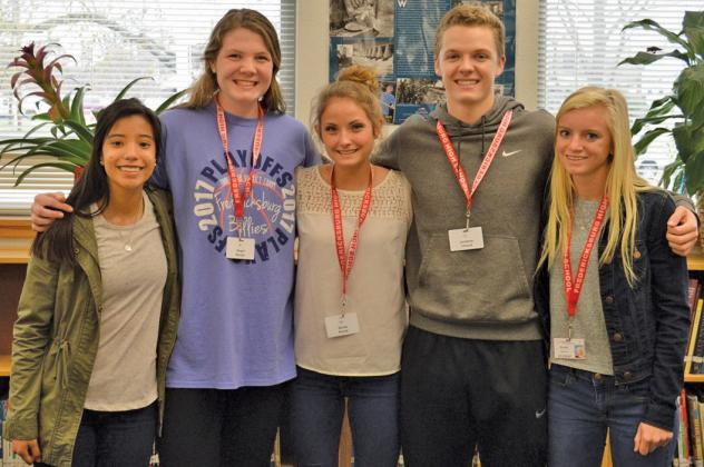 Fredericksburg High School students, from left, Aylin Neri, Abigail Spurgin, Nicole Penick, Jonathan Cleland and Hannah Boubel will play competitive sports at the college level. — Photo by Luis Diosdado