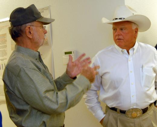 Ag Commissioner Sid Miller, right, visits with Fredericksburg Winery owner Cord Switzer. - FSRP file photo
